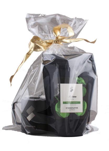 Bilde av termokopp og kaffepose i cellofanpose